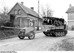 A German Raupenschlepper Ost (caterpillar tractor east) pulling a 7.5 cm PaK 40 in Northern France, October 1943.