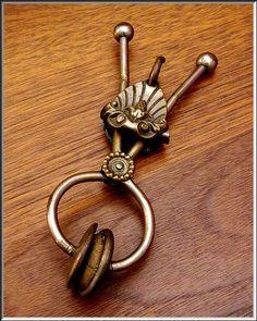 Brass skirt lifter w/o cord. c 1876