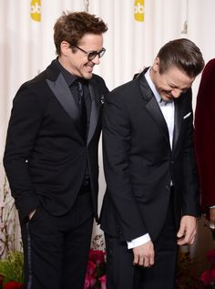Robert Downey Jr. and Jeremy Renner at the 2013 Oscars