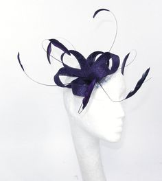 Deep Purple Fascinator Hat for Weddings, Cocktails, Church and Derby. $55.00, via Etsy.