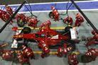 Fernando Alonso (ESP) Ferrari F2012 makes a pit stop.  Formula One World Championship, Rd14, Singapore Grand Prix, Race, Marina Bay Street Circuit, Singapore, Sunday, 23 September 2012