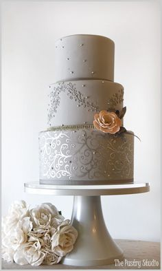 A Chic Gray and Silver Wedding Cake accented with a touch of Peach