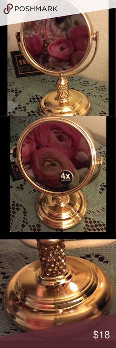 NWT Small Vanity Mirror NWT Small copper/rose gold, vanity mirror with jeweled base. Mirror revolves to x4 magnification. A darling little mirror  for putting on your mascara and eyeliner. Beautiful Mother's Day gift, Birthday gift, or something special just for you. MB Modern Beauty Accessories