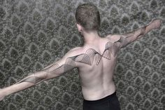 The incorporation of modern art into tattoo design is gaining steam world-wide, and one of the tattoo artists at the forefront of this movement is Chaim Machlev, whose beautiful line tattoos often look like complex geometric simulations that we'd normally expect to see on a computer screen.