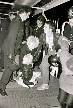 Debbie Juvenile, Vivienne Westwood and other punk fans, getting arrested at the Pistols Infamous Silver Jubilee Boat Party, at the Thames, London 1977