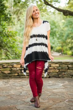 TREND ALERT! We can't quite pinpoint what it is about this tie-dye style that has everyone so crazy, but we are not complaining! The classic black and white in such a modern hi-lo top creates a stunning juxtaposition that has us nearly salivating! We know you're just as fashion hungry as we are, so get your hands on this top before the last one is gone!