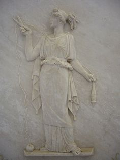 Bas relief of Atropos, one of the three Moirae, Greek goddesses of fate and destiny, cutting the thread of life.