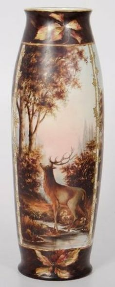 pottery & porcelain, France, A Limoges porcelain painted vase, French, late 19th to early 20th century, bowed cylindrical form, having a flared mouth and foot, polychrome and gilt decorated panels of deer set within landscape, marked T&V / Limoges / France (for Tressemanes [Tressemann] & Vogt Limoges Porcelain).