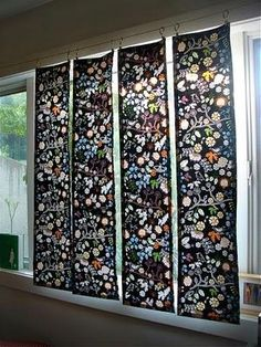 Curtains in panels. Cute! Would be cool with the multiple track curtain rods from IKEA