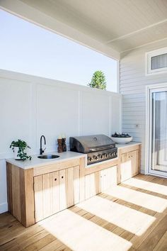 an outdoor kitchen with fully-integrated appliances, blackbutt - Modern Outdoor Kitchen Patio, Outdoor Kitchen Cabinets, Farmhouse Kitchen Island, Outdoor Kitchen Design, Outdoor Living, Outdoor Decor, Rustic Outdoor, Small Outdoor Kitchens, Outdoor Rooms