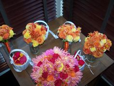 Orange and Pink! Dahlias, Alstroemeria and roses dressed up these fun and colorful bouquets for an equally fun bride!