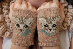 12 by tiny_owl_knits, via Flickr  http://www.ravelry.com/patterns/library/meow-mitts  I am so going to knit these!