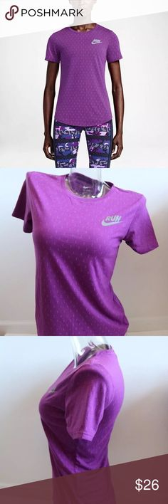 Nike Women's Digital Dots Purple Print Running Tee BREATHABLE AND LIGHTWEIGHT The Nike Print Digi Dots Women's Running Shirt is made with Dri-FIT fabric and reflective print detail for lasting comfort and visibility in low light. Product Details Rib crew neck with interior taping Fabric: Dri-FIT 75% polyester/13% cotton/12% rayon Nike Tops Tees - Short Sleeve