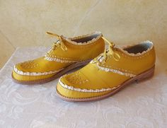 DANDY  All my shoes are handmade, from illistration and pattern to clicking and stiching to lasting and making . I love all the stages of making a shoe, from flat leather to a form of sculpture