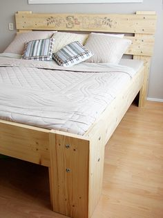 Love the look and shape of this rustic bed frame. Not keen on the headboard stitching