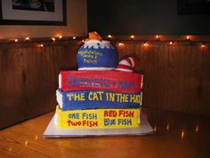 Dr. Seuss cake Cat in the Hate with books, fish and fish bowl - Erin Miller Cakes - https://www.facebook.com/erinmillercakes