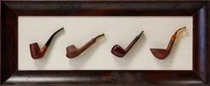 A set of wooden smoking pipes hinged on a woven mat creates a family keepsake that can be handed down for generations.