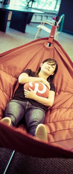 A Day at the Pinterest HQ: A team member takes a nap in the upstairs hammock while cuddling a Pinterest pillow…      - photo from #treyratcliff Trey Ratcliff at http://www.StuckInCustoms.com - all images Creative Commons Noncommercial