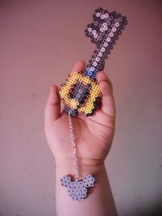 The original Keyblade from the Kingdom Hearts series in pixel form! Chain is also done by hand, which takes a lot of pain and effort to make. A must-have for every Kingdom Hearts fan!