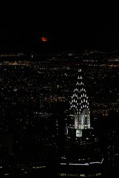 Bloody moon over Manhattan, NYC - I took this shot from the top floor on the Empire State building. I remember that the terrace was so crowded that i was fighting my way to reach to the bars and to take the shot of the moon together with the Chrysler building. The guards told me that this moment is not happening so often and that i was lucky to be at the right place at the right time.