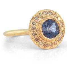 Blue Sapphire Halo Ring    Blue sapphire champagne diamond halo engagement ring.  0.85 carat natural unheated purpley-blue sapphire with champagne diamonds set in 14K yellow gold miligrain halo, tapered 2mm band     $2950