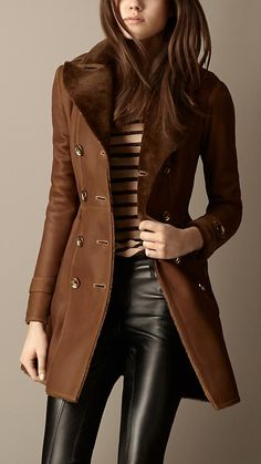 Shearling coat and leather pants. Awesome combo of color and texture.                                                                                                                                                      More