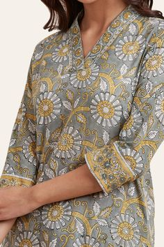 Crafted in a classic straight silhouette, the Nausheen Ruhi Short Kurta showcases a contemporary style. Graced with an exquisite block print in subtle tones, intricate hand-embroidered sequins work and elegant mirror work further adds to its allure. Salwar Designs, Kurta Designs Women, Kurti Designs Party Wear, Neck Designs For Suits, Dress Neck Designs, Blouse Designs, Salwar Pattern, Kurta Patterns, Kurtha Designs