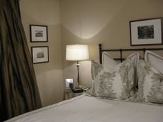 bedrooms - Sherwin Williams - kilim beige - bedding lamps chocolate brown silk drapes lamp. iron bed Bedroom Chocolate brown silk drapes