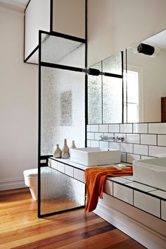 Nice black-and-white tile, and use of the glass to separate sections of bathroom.