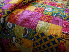squares... a good way to start...and gorgeous colorful fabrics here.