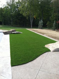 Residential installation of Dupont™ ForeverLawn® Select Synthetic Grass.
