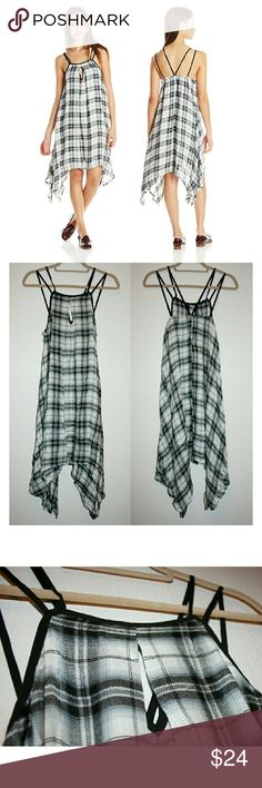 Stunning Plaid Swing Dress NWOT This gorgeous plaid swing dress is incredibly comfortable and soft. The black, gray and white fabric is 100% rayon twill in and feels a lot like a scarf. It features a keyhole in the neckline, double straps, and an elastic band around the back to keep the top fitted. It's a juniors medium, so I listed as small. Dresses Midi