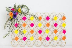 Shake up your escort card table with gilded geometric wall art, neon color, and some au naturale corner blooms! Florals: Hello Darling Venue: Chez Escort cards: Invitations By Design Photo: Elle Rose Photo Planner: Cheers! Chicago