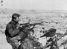 "3rd SS Panzer Division ""Totenkopf"" members in a fighting position in the Russian steppe."