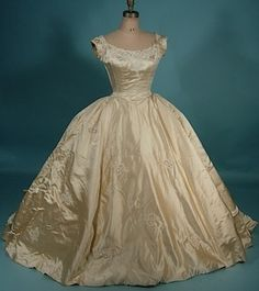 1950's wedding gown.  If I were to go ball gown it would have to be vintage! amazing. Also, I'm digging cream/off white more and more.