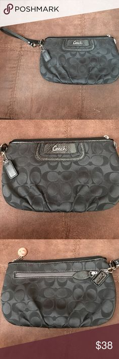 Coach Black wallet wristlet Coach black wallet wristlet with 8 slots inside for credit cards or IDs in great condition Coach Bags Wallets