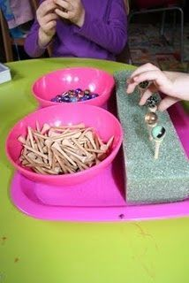 Balance marbles on golf tees. Fine motor skills. Physical Development. Continuous Provision. Teaching. Classroom. Resources. EYFS. Early Years. Reception. Children. Learning.