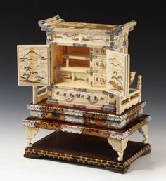 A superb Japanese ivory cabinet on stand