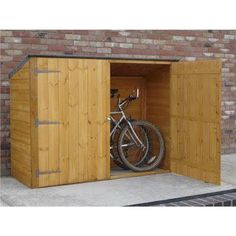 Looking for a reliable bike shed to protect your bike? Visit Shedstore to explore our metal bike sheds or wooden bike storage sheds. Backyard Sheds, Outdoor Sheds, Outdoor Toys, Shiplap Cladding, Garage Velo, Buy Shed, Shed Makeover, Wooden Sheds, Garden Cottage