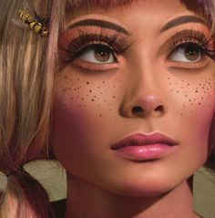 ahh, instead of covering up freckles, this model is wearing drawn on ones. finally! some appreciation :) haha