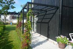 Pergola...extend from house to poles in planter...only cover partially over fire pit area