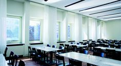 Make use of curtains and shades in dining halls; the shades are motorized for easy operation with no cords.