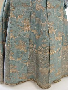 Detail back view, child's dress, France, 1725-1750. Pale blue silk with floral and ornamental metal thread embroidery.