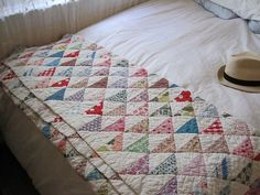 Simple but beautiful HST quilt with 30's reproduction feedsack fabrics.
