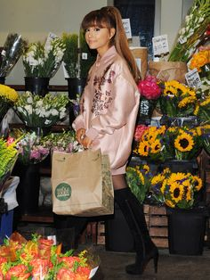 Think thigh-high boots are solely for winter? Pair your silky oversized bomber jacket (the boxier, the better) with a pair of over-the-knee bad boys (à Ariana Grande) for an instant update on your summer look. Grocery bag and flowers, optional. Ariana Grande Wallpaper, Satin Bomber Jacket, Dangerous Woman, Celebs, Celebrities, Demi Lovato, Thigh Highs, Sober, Style Icons