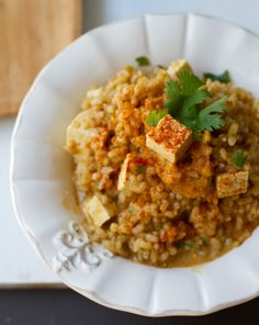 Peanut-rice 2 1/2 cups brown rice, cooked 1 1/4 cups firm tofu, cubed garnish: cilantro + chopped peanuts Sauce: 3 Tbsp peanut butter 1 Tbsp white miso paste or lime juice 2 1/2 tsp agave syrup 3/4 cup water 2-3 tsp tamari or soy sauce  optional: 3-4 dashes cayenne powder