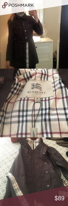 Burberry Raincoat Not authentic but an extremely good replica. Never worn. Coat can be worn many different ways. Paid 150. Burberry Jackets & Coats