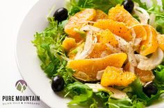 Orange Lovers | Pure Mountain Olive Oils and Vinegars | www.puremountainoliveoil.com | Mixed greens topped with naval oranges and black olives, tossed with a delicious Lemon vinaigrette. Add some chicken and make it a meal! | #extravirginoliveoil #nocellara #lemonbalsamic #lemonwhitebalsamic #orangesalad #olives #salad #saladdressing #dressing #healthyrecipe #recipe