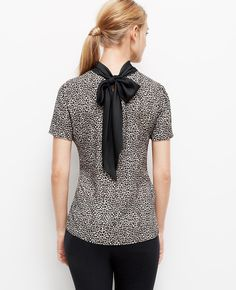 Throw your hair in a high-pony, and show-off this super femme Cheetah Print Bow Back Top. Perfect for post-work cocktails.