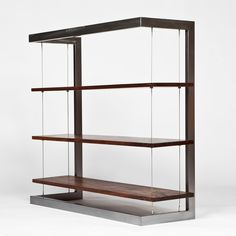 Suspended Bookshelf // Walnut. Great for a home business. Professional yet open and welcoming.